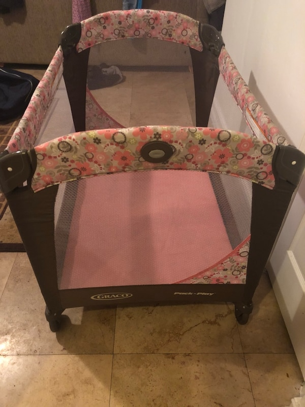 Used Baby S Black And Pink Graco Pack N Play For Sale In