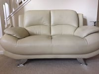 Leather padded loveseat