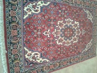 red, white, and black floral area rug KELOWNA