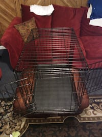 Large dog cage has aside door and a front door  Baltimore, 21224