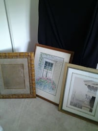 two house paintings and brown wooden photo frame
