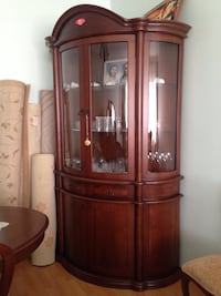 brown wooden framed glass display cabinet Christchurch, BH23