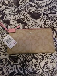 Brand new Coach wristlet/wallet with pink lining