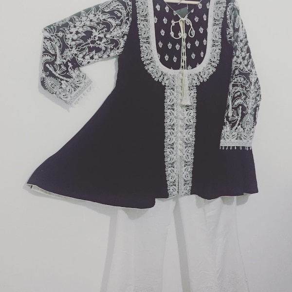 White and black embroidery outfit with matching boot cut same as green outfit. Brand new haven't used. b7f984ee-2c3f-49eb-b66d-f0f6ab357210