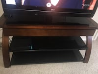 Black wooden framed glass top tv stand Sterling, 20165