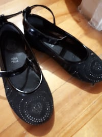 pair of black mary jane shoes