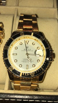 round gold Rolex analog watch with gold link bracelet Brampton, L6T