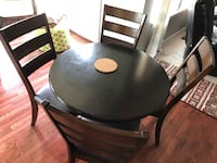 Round black wooden table with four chairs dining set Woodbridge, 22192