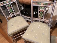 two white and brown wooden chairs