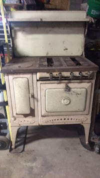 Woodburning and gas stove antique. Waldron, 46182