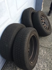 (obo) p185/65r15 all seasons with tire rims