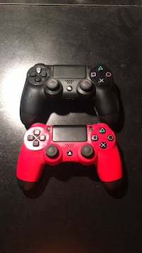 black Sony PS4 Slim with two red and black controllers Thunder Bay, P7C 5C7