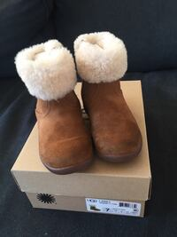 Kids UGG fur-lined boots size 7