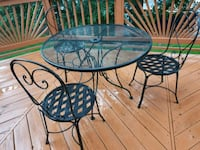 round black metal table with two chairs patio set