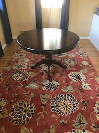 Round black wooden pedestal table Annandale, 22003