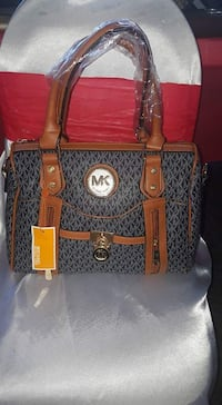 gray and brown Michael Kors shoulder bag