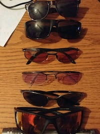 three black and brown framed sunglasses 3729 km