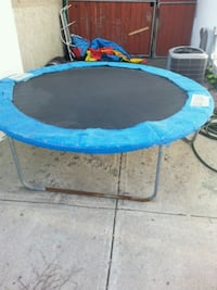 blue and black trampoline with enclosure Calgary, T2C 2G2