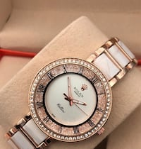 round silver-colored analog watch with link bracelet null