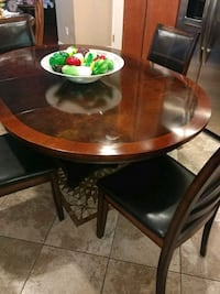 Dining room table with 4 leather and solid wood ch Hemet, 92545