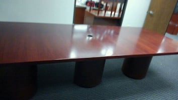 $1,000 Conference table seats 12