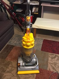 yellow and gray Dyson upright vacuum cleaner Houston, 77098