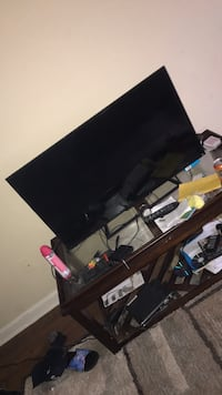 black flat screen TV with black TV stand Atlanta, 30331
