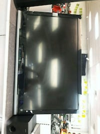 black flat screen TV with remote Naples, 34104