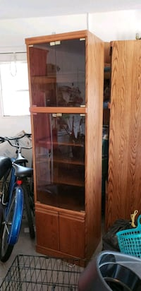brown wooden framed glass door Sebastian