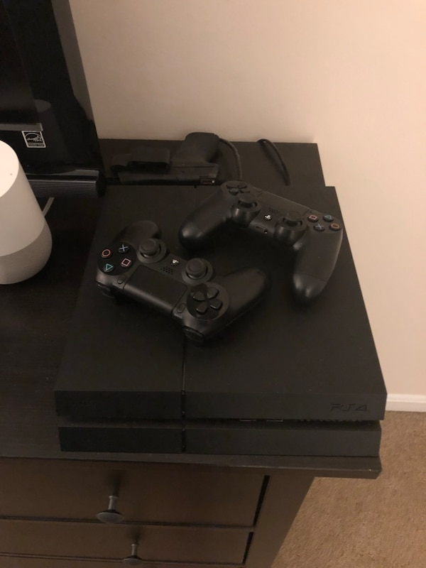 PS4 with 2 DualShock Controllers