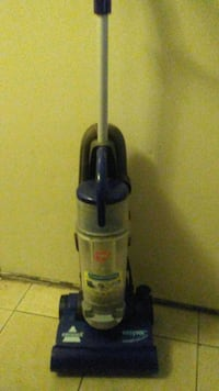 gray and blue upright vacuum cleaner