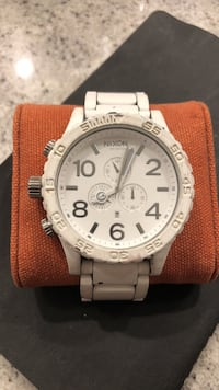 round silver chronograph watch with brown leather strap Langley, V3A 1S5
