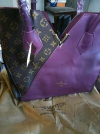 New purse $65 firm pick up in West Oakland