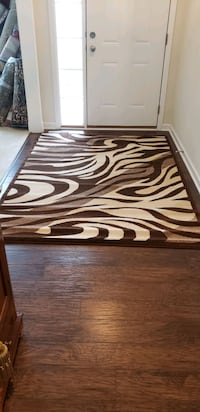Brown and cream, zebra design, new,5'by8' area rug