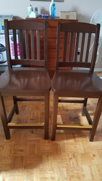 2 wooden high back chairs