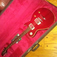 red electric guitar in case Stafford, 22554