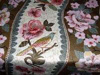 white, pink, and green floral textile Olney