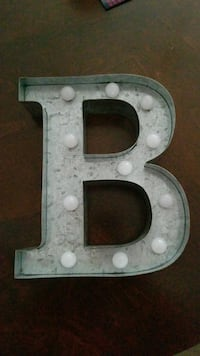 Battery operated lighted letter B.