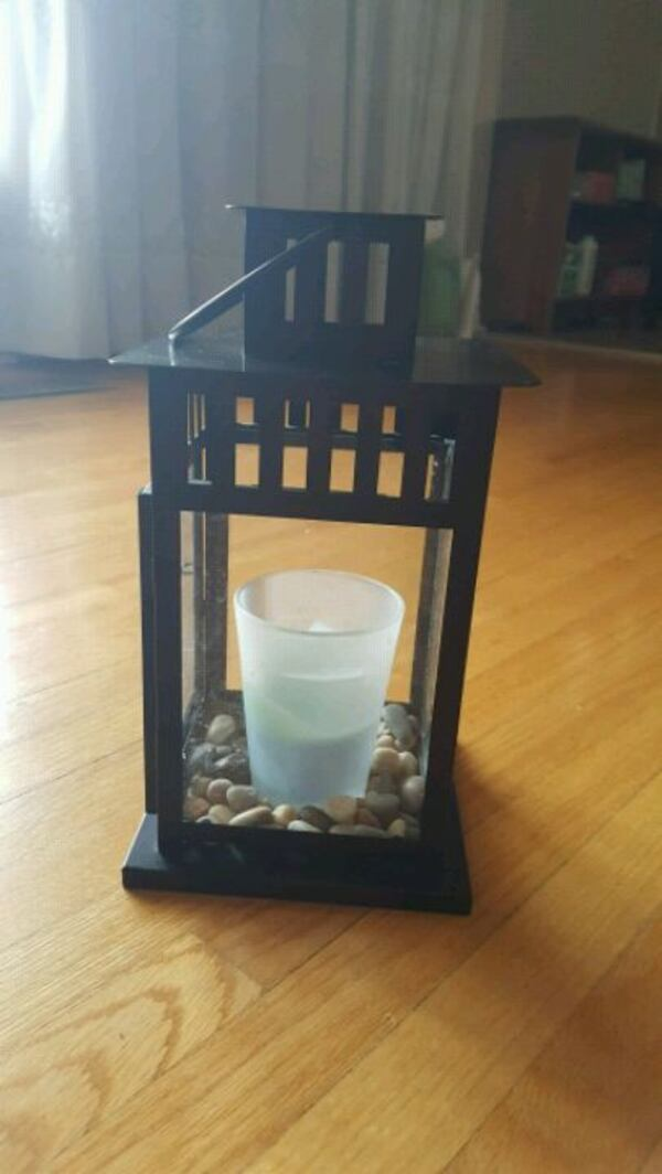 Lantern candle holder and candle in glass a01a4092-58d2-46a4-bff0-993a38ec1687