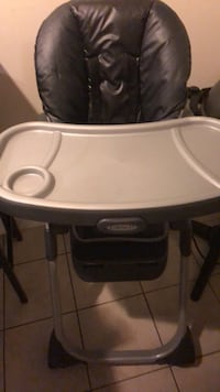 white and black Graco highchair 50 km