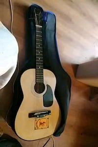 brown acoustic guitar with black case Norfolk, 23503