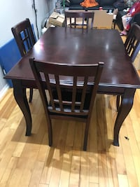 rectangular brown wooden table with four chairs di Markham, L3S 3V8