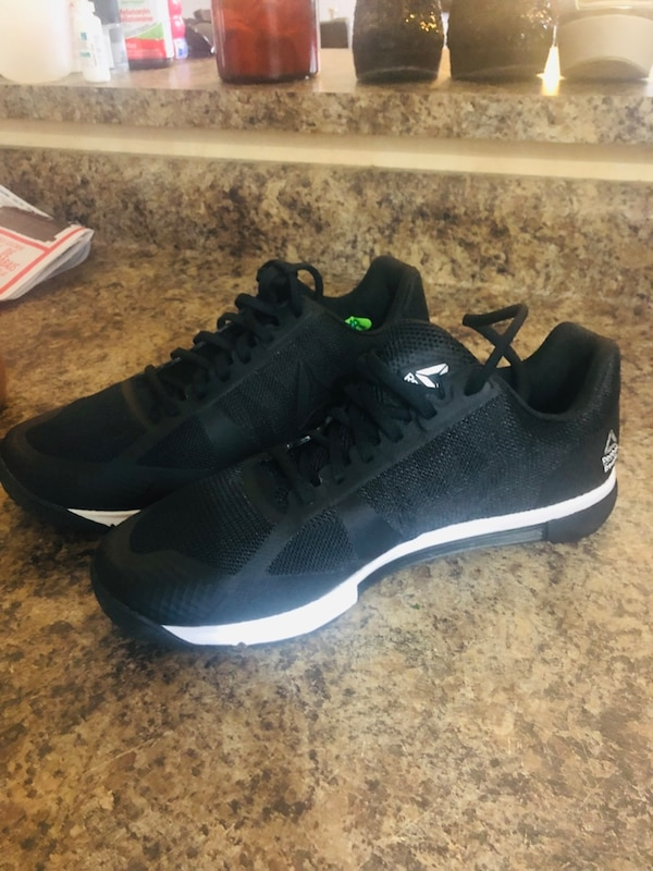 Pair of black-and-white adidas running shoes