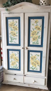 white and blue wooden armoire