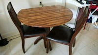 round brown wooden table with four chairs dining set Staten Island, 10302