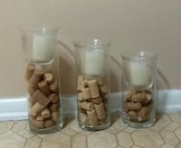 3/UNIQUE CANDLE HOLDERS WITH LED CANDLES......EXCELLENT CONDITION 634 mi