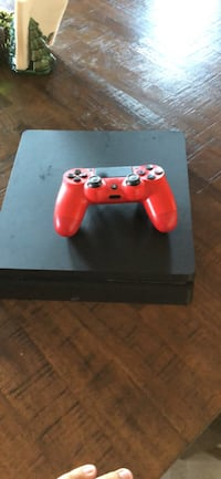 black Sony PS4 with red DualShock 4 Laveen