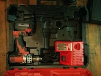 red and black Milwaukee cordless power drill with case Vancouver, V6P 4S1