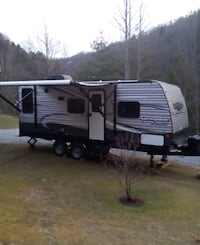 white and gray camper trailer