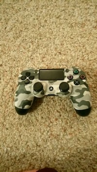 white and black camouflage Sony PS4 controller 3142 km